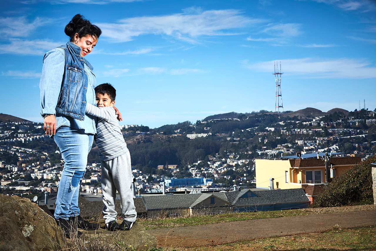 Fabiola Gudiel snuggles with her son, Steven Mendoza, on a sunny day in San Francisco