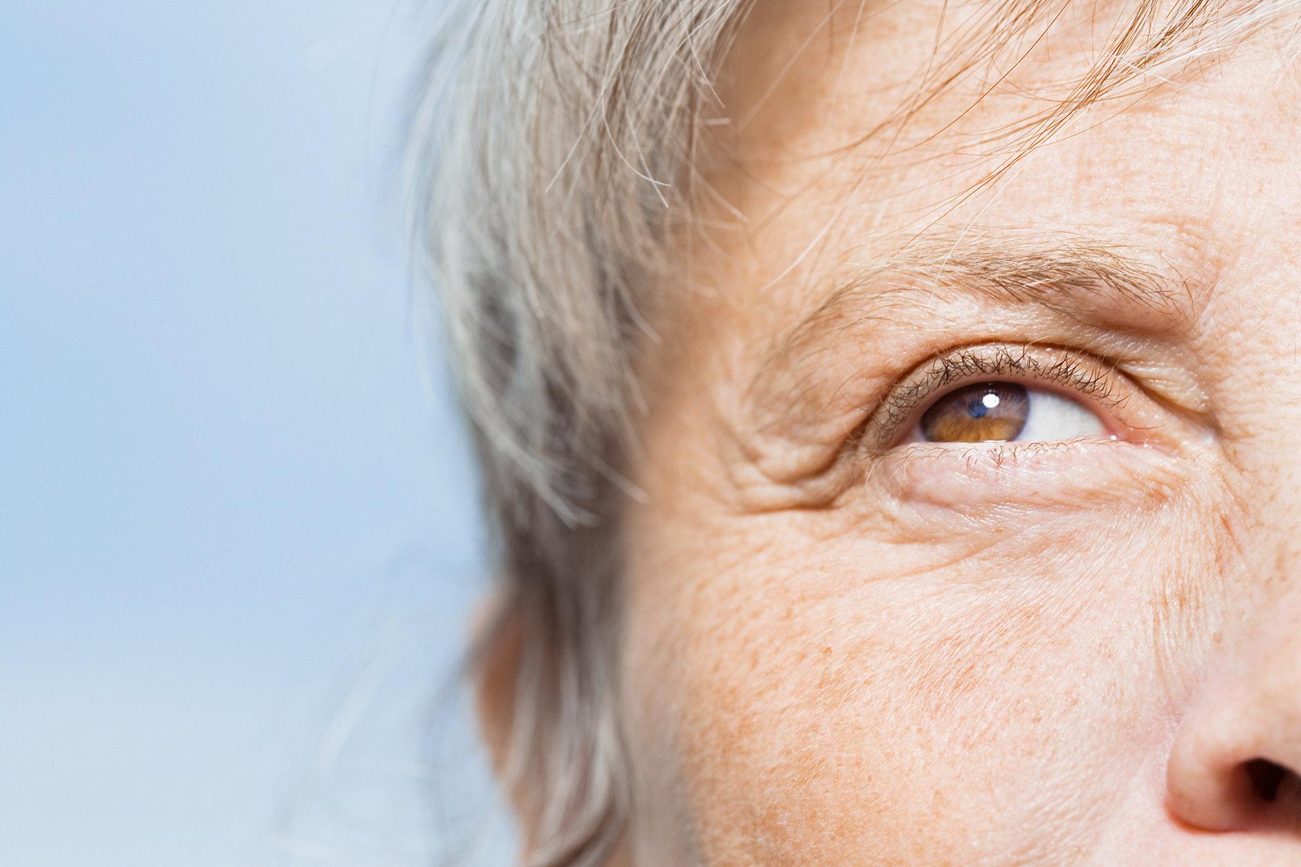 older woman closeup face eyes iStock.