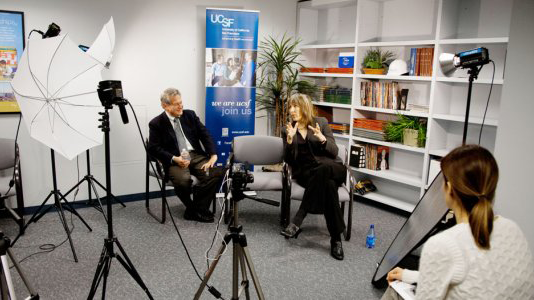 two UCSF faculty members being interviewed by media