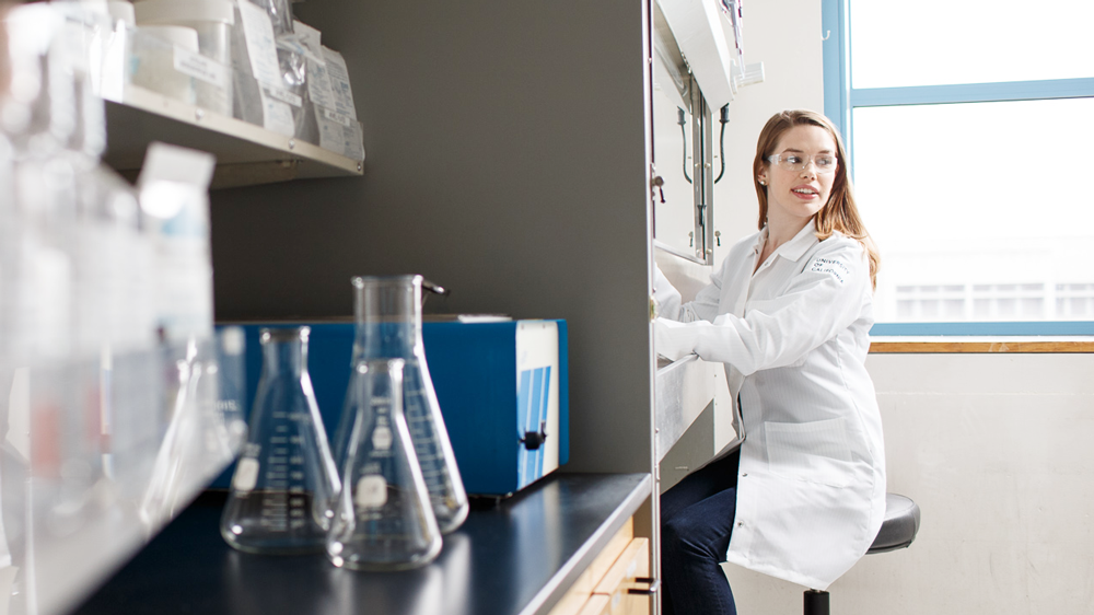 A researcher works in the lab at the UCSF Helen Diller Comprehensive Cancer Center