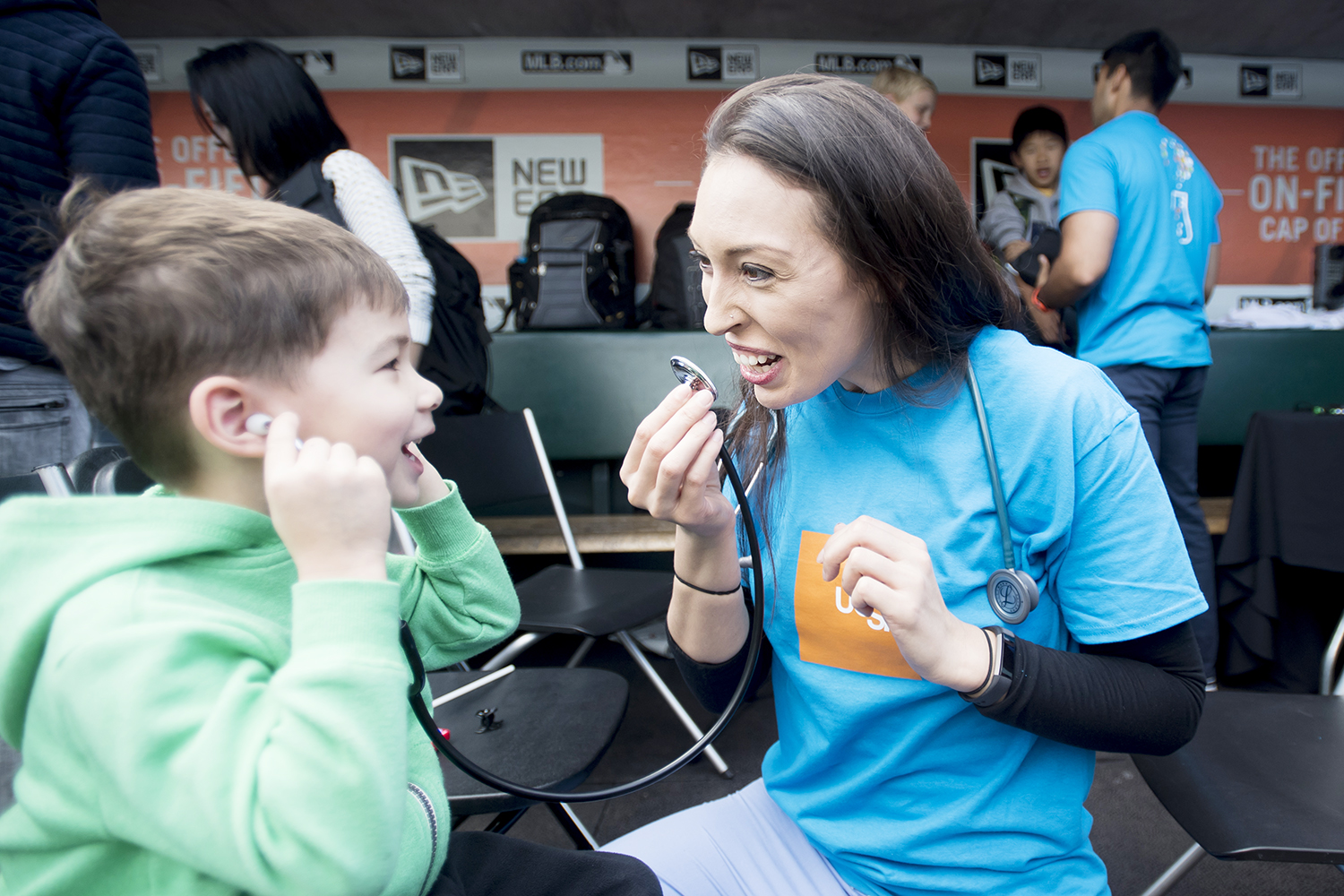 Misty Montoya teaches a child about stethoscopes at one of UCSF's hands-on learning exhibit