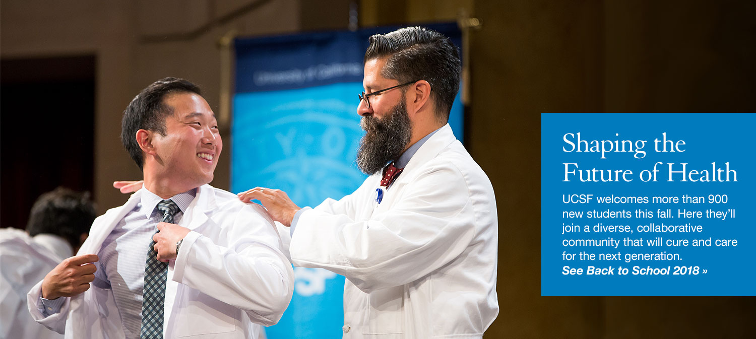a student receives his white coat