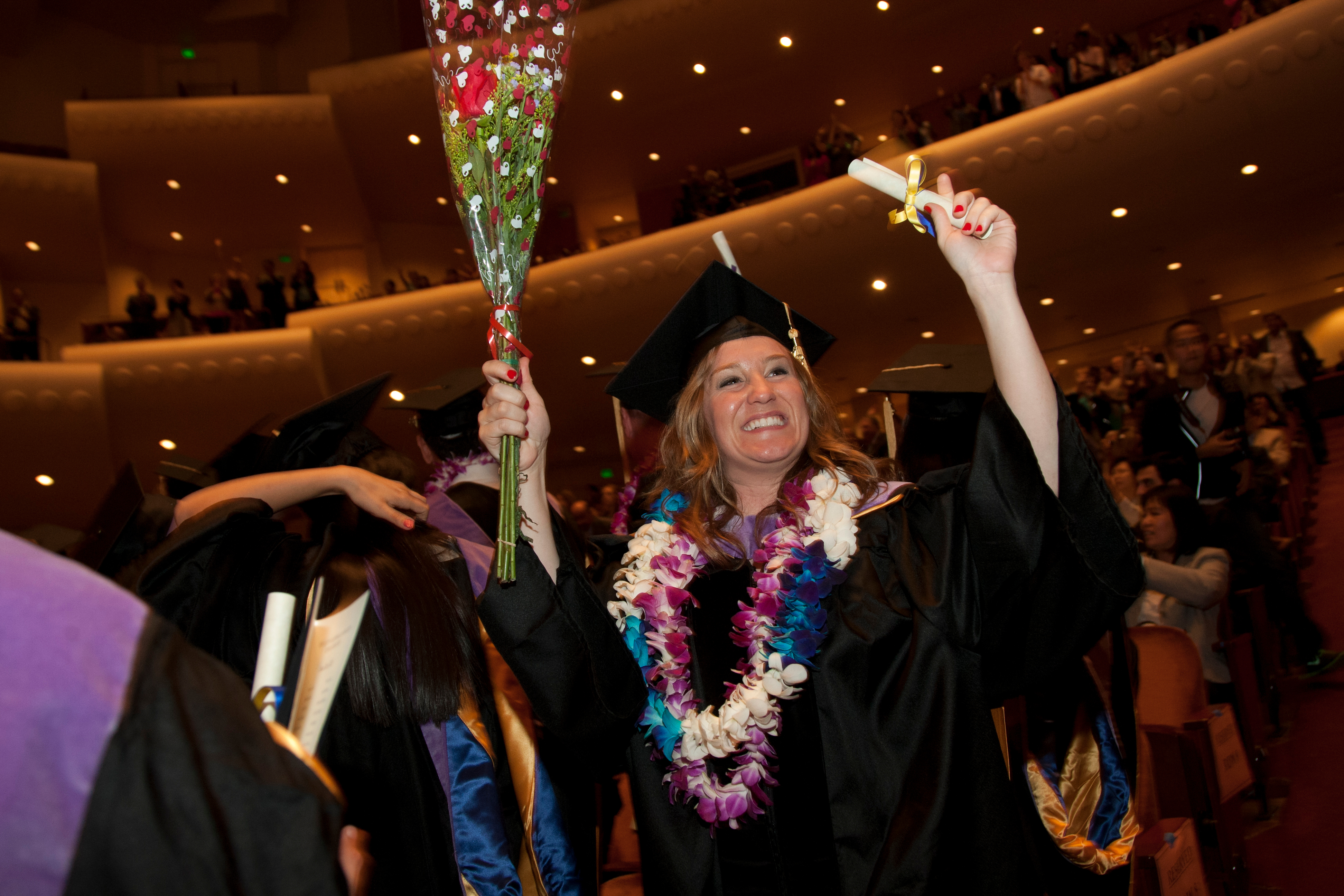 Graduates cheer after receiving their degrees from the School of Dentistry, which strives to be a worldwide leader in dental education and public health, clinical practice and scientific discovery.