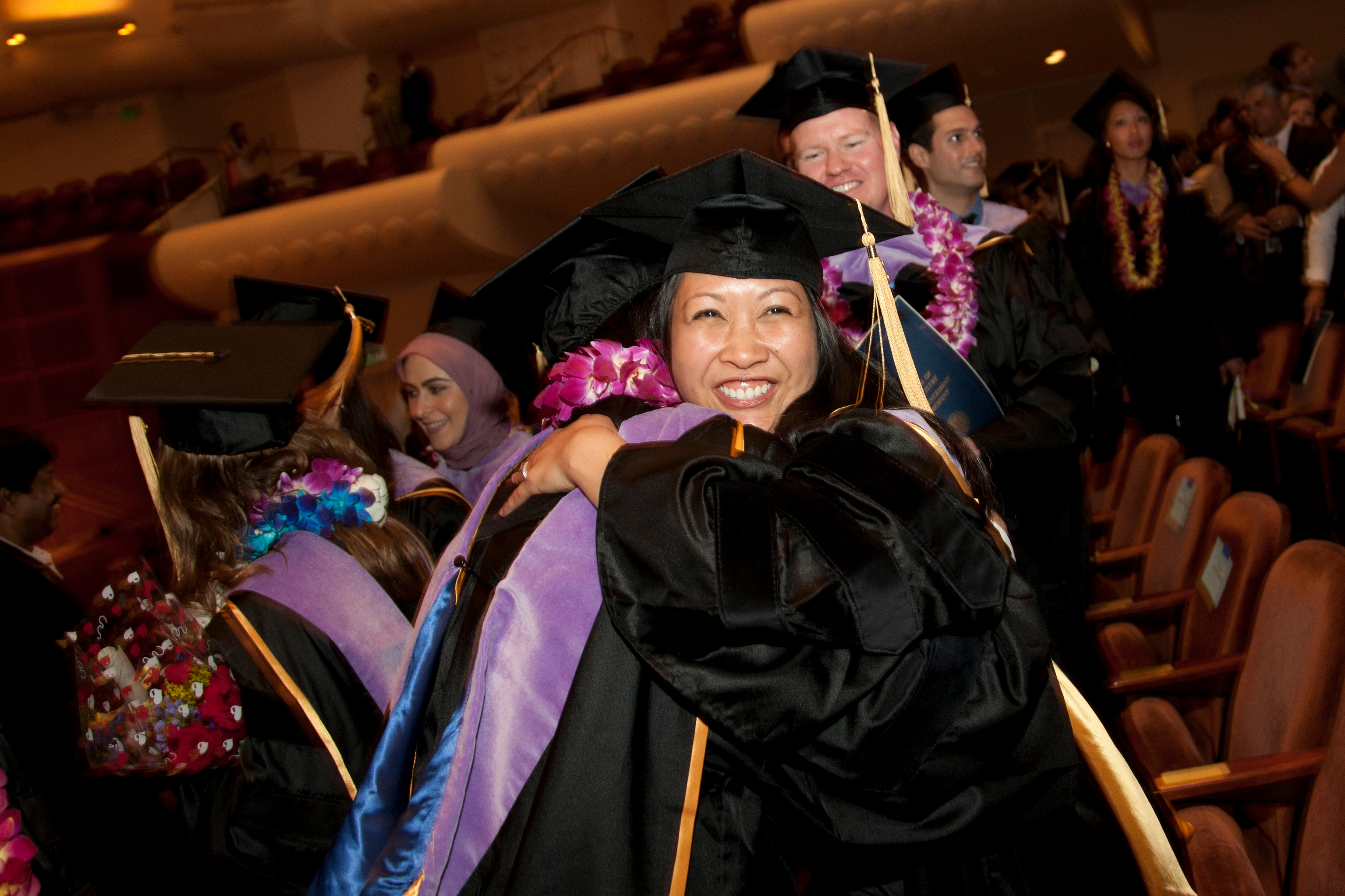 Graduates rejoice in the successful completion of long journey in education that began many moons ago as kindergartners.