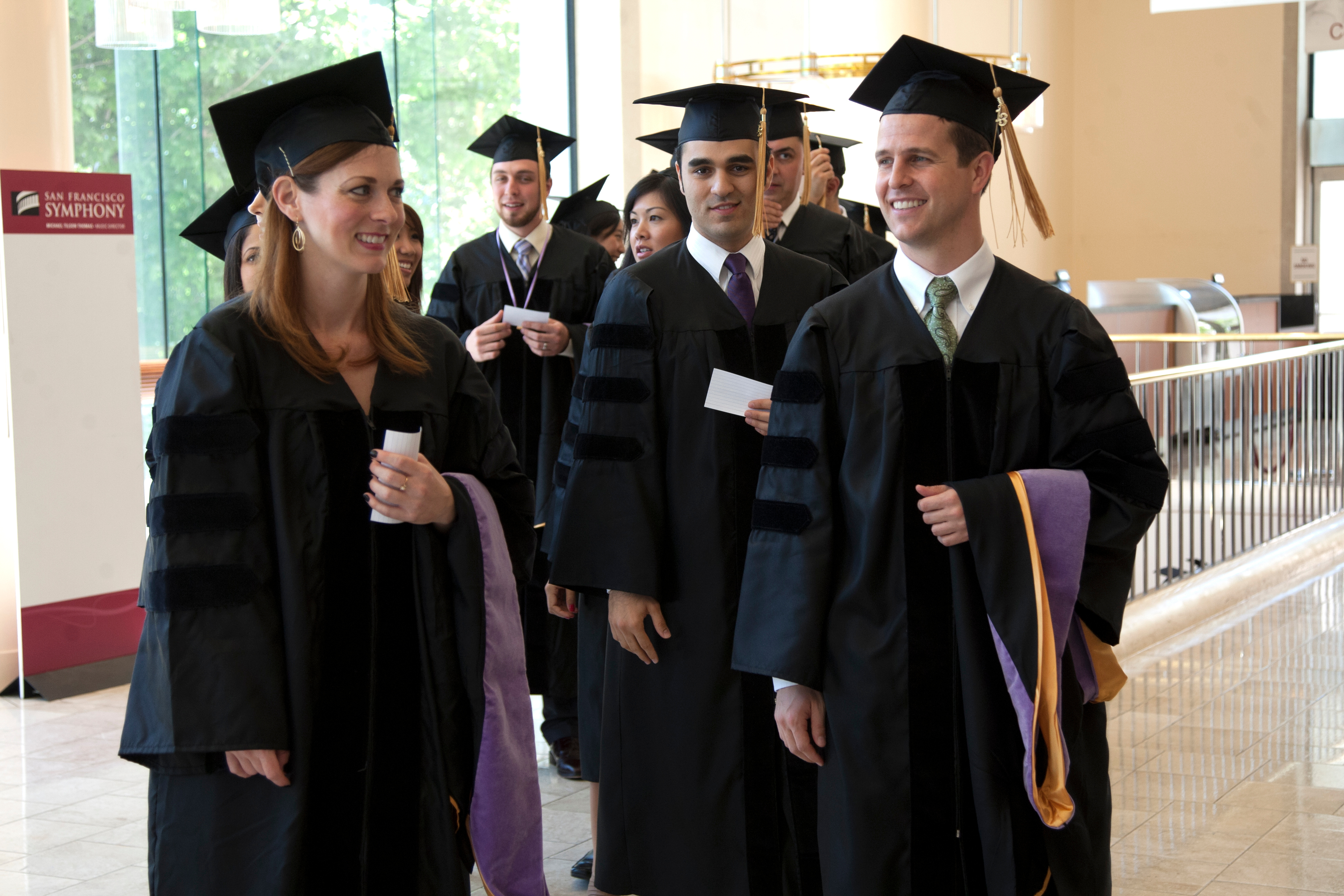 Dental students show their excitement in the final moments before heading into the hall to receive their diplomas.
