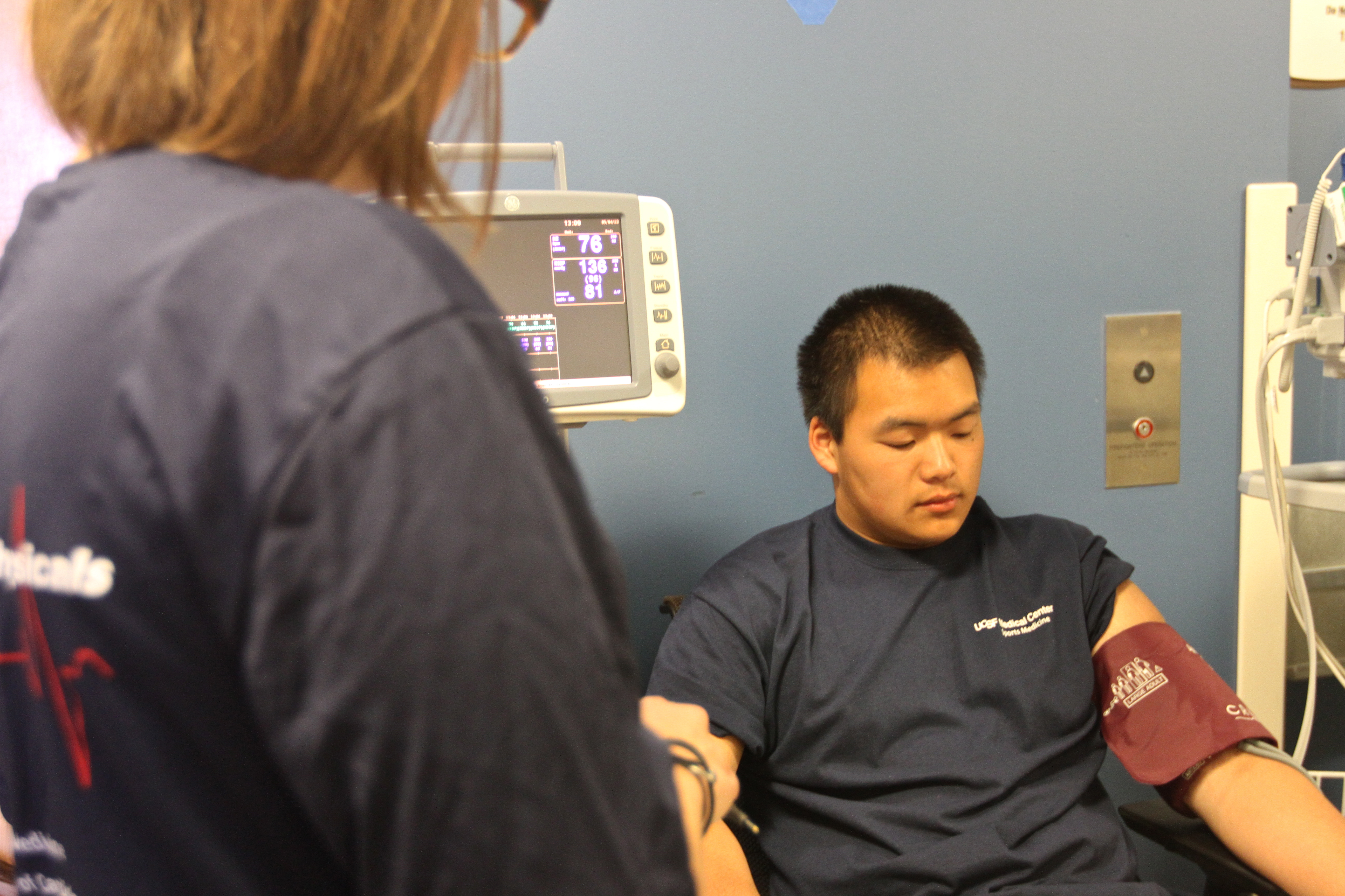 Then, the student athlete gets his/her blood pressure checked.