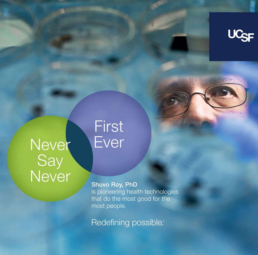 UCSF advertisement showing a closeup of a scientist's eyes looking intently. Text reads: Never say never, first ever