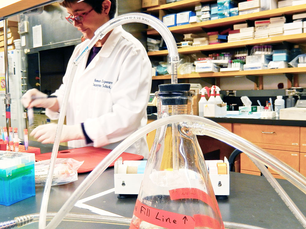 a researcher works in the lab at San Francisco General Hospital