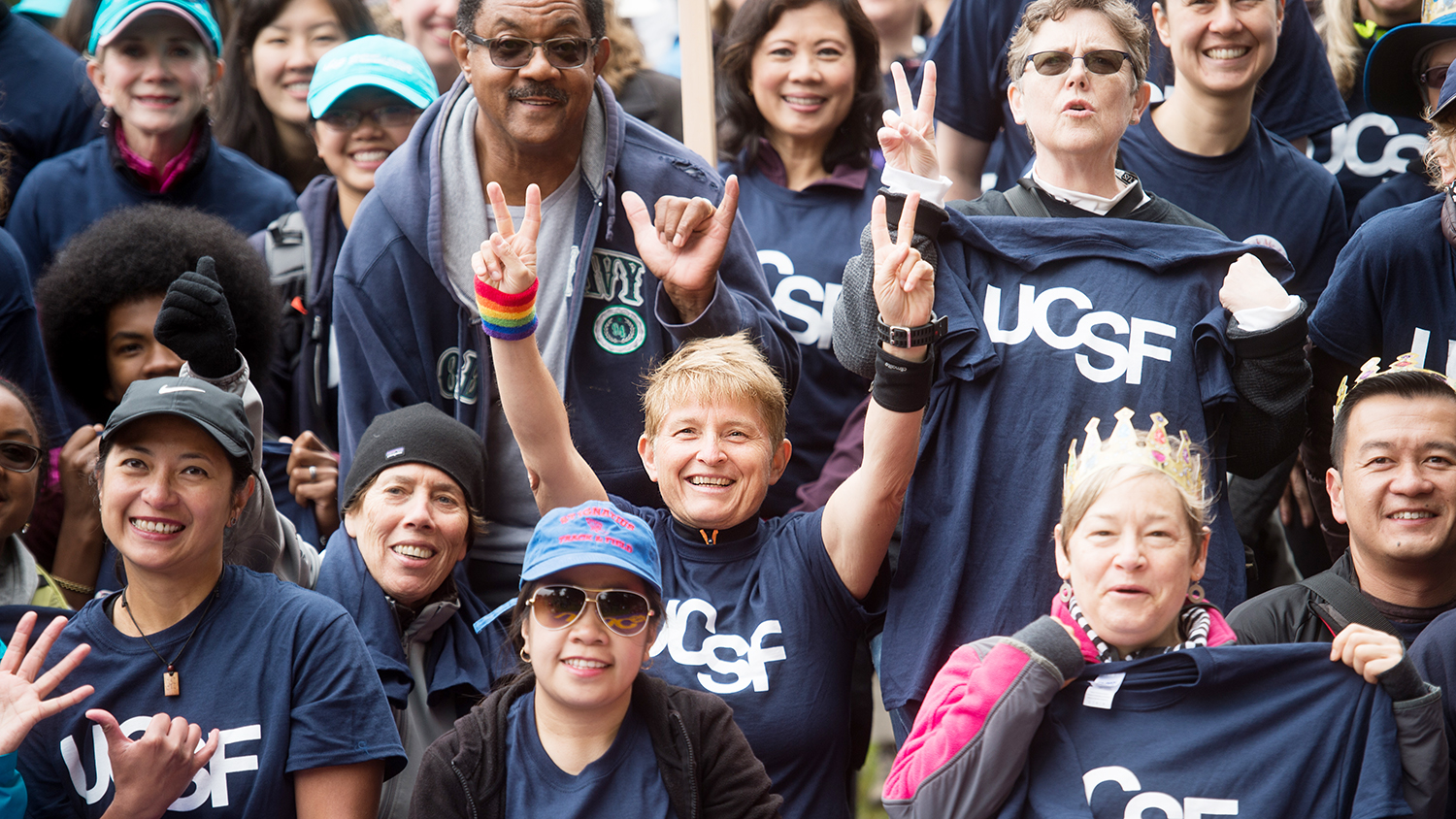 a group of people wear UCSF tshirts at the AIDS Walk SF