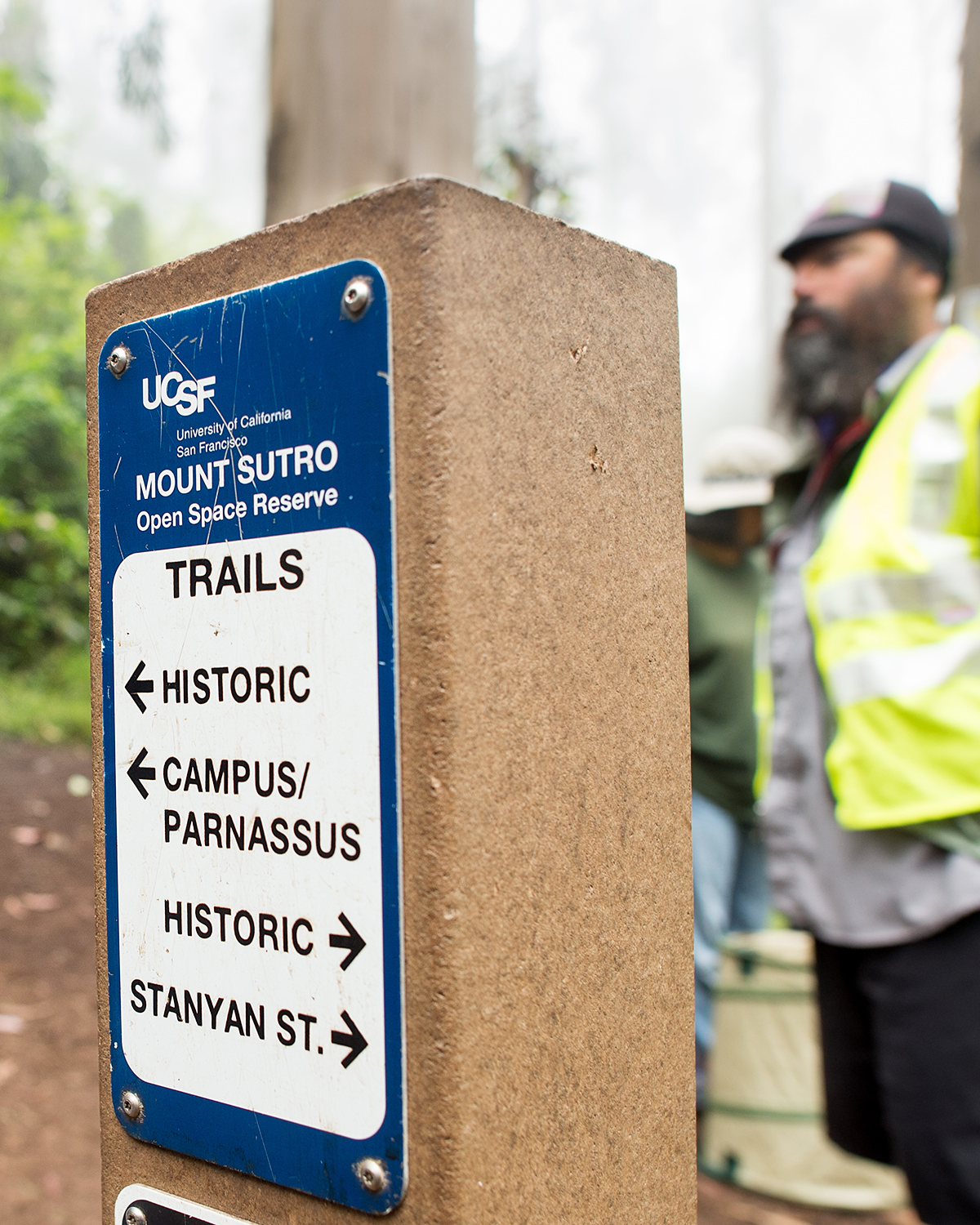 A sign on Mount Sutro points to the Historic Trail, the Parnassus Campus and Stanyan Street