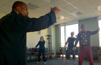 Joseph Acquah, OMD, teaches qigong to a group of patients