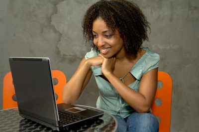 Stock image of woman browsing her laptop