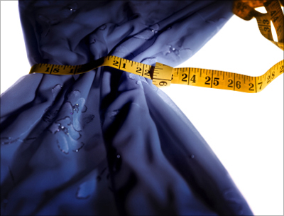 Measuring tape around an evening gown
