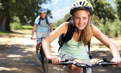Stock image of teens riding bikes