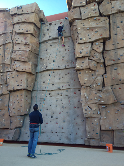 Amputee athlete Kristen Lusk, 14, scales up a 45-foot rock wall