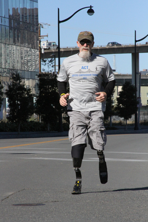 Vietnam War veteran Tim Woodville goes for a brisk run at UCSF Mission Bay.