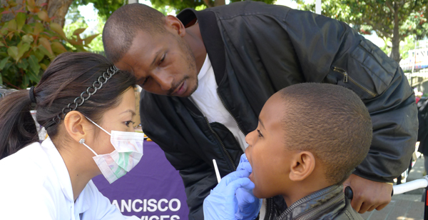 A boy gets a free dental screening in the Bayview.