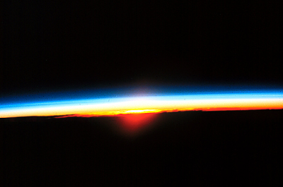 A rarely-seen view of a sunrise from outer space.