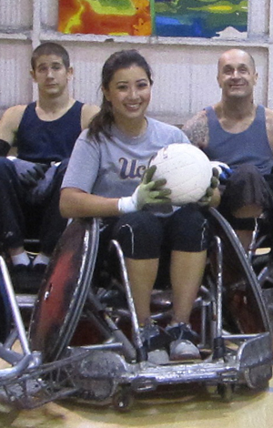 Angelica Galang, left, and her teammates with the United States Quad Rugby Assoc