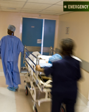 Stock photo of medical professionals rushing patient to ER