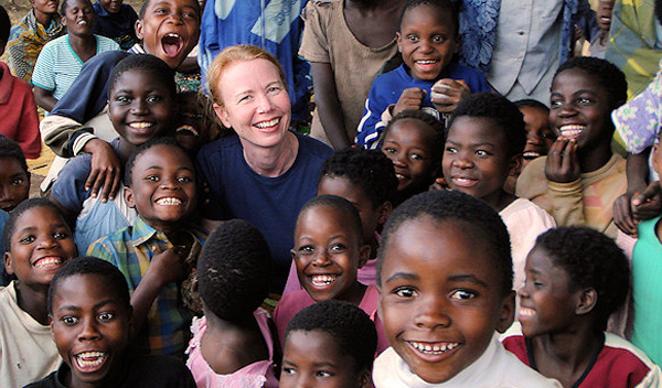 Susan Kools with children in Malawai, Africa