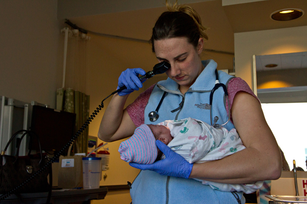 Pediatric resident Alison Kuchta performs routine tests for newborns on 6-hour-o