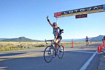 Heidi Dohse finishes a 206-mile bike race.