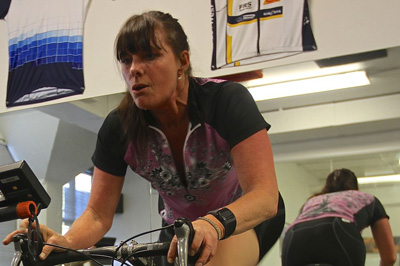 Heidi Dohse exercises on a stationary bike.
