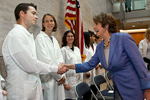 Democratic Leader Nancy Pelosi greets scientists at UCSF Mission Bay.