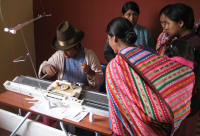 Women in Chitipampa, Peru, examine new sewing equipment at a textile factory
