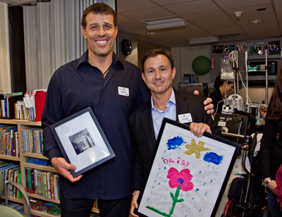 Tony Robbins and Walter Rogers receive special gifts created by patients at the
