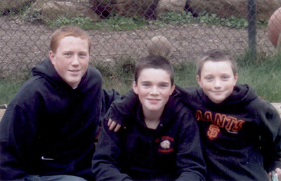 Sean White, far right, poses with his older brothers Riley and Logan.