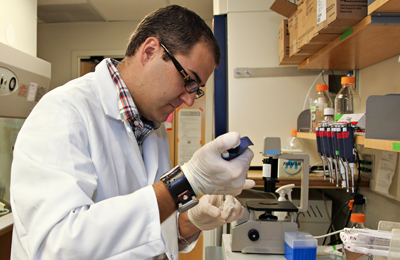 Michael Page, PhD, works in the lab.