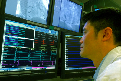 Zian Tseng, MD, reviews the electrical activity of a patient's heart at the UCSF