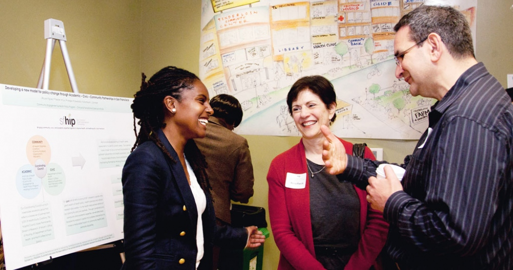 People chat during a gathering of the San Francisco Health Improvement Partnership