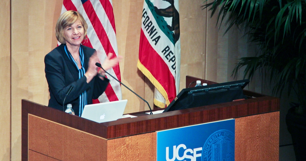Chancellor Susan Desmond-Hellmann at the podium during the 2011 State of the University address