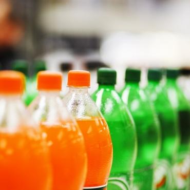 soda bottles on a supermarket shelf