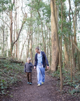 woman walking on the Sutro trail with her toddlerson