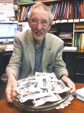 Bruce Ames holds a tray of CHORI bars
