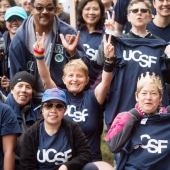 UCSF faculty, staff and students pose for a photo in matching blue UCSF T-shirts before the 2016 AIDS Walk San Francisco