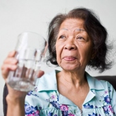 Senior woman holding water glass