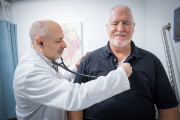 Jeffrey Olgin, MD with a patient.