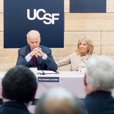 Jill Biden puts her hand on Joe Biden's back during an emotional moment