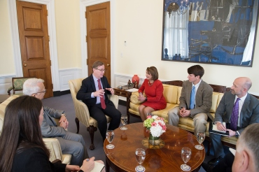 UCSF Chancellor Sam Hawgood talks with Rep. Nancy Pelosi, D-Calif., and members of her staff in her office in Washington, D.C.