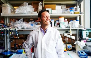 Sergio Baranzini smiling in his lab.