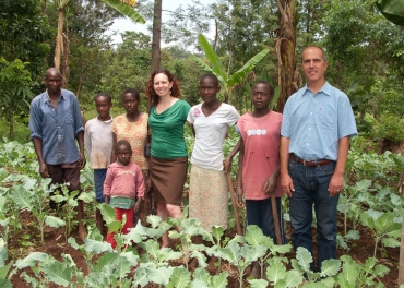 Kenyan farmers standing with researchers