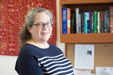 Sophie Dumont, PhD, stand in her office at UCSF