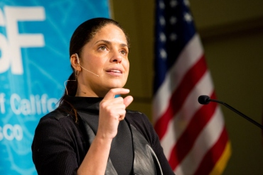 Soledad O'Brien speaking at the podium