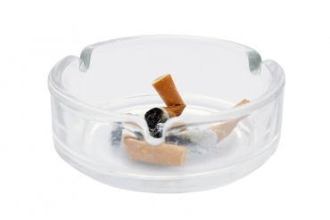 Used cigarettes in a clear ash tray
