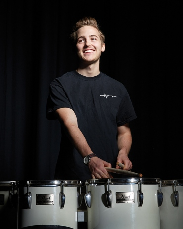 Portrait of Oliver Bishop playing the drums
